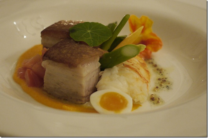 Butter poached lobster with slow-roasted pork belly and quail egg