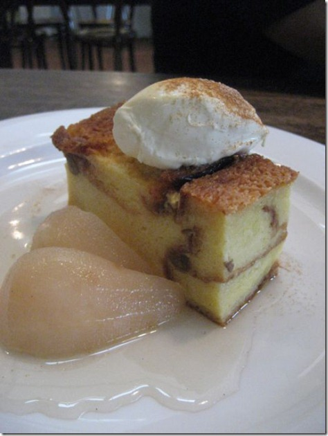 Bread and butter pudding with poached pear and double cream