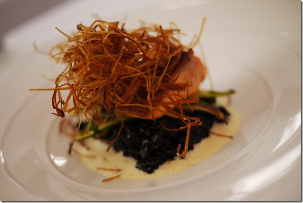 Squid ink risotto with ocean trout