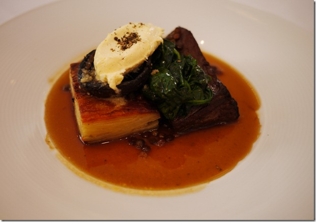 Beef cheeks with potato gratin and horse radish
