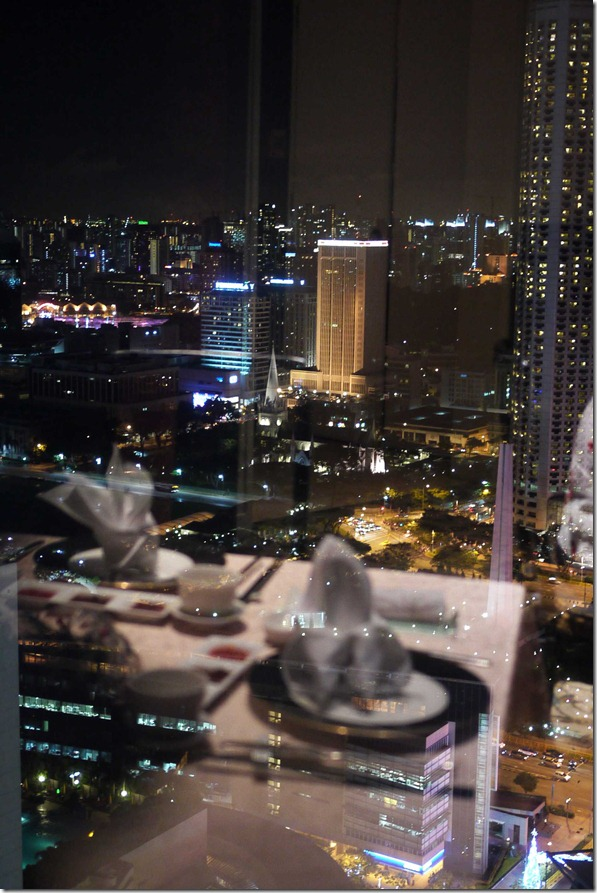 Singapore skyline with reflection of our dining table