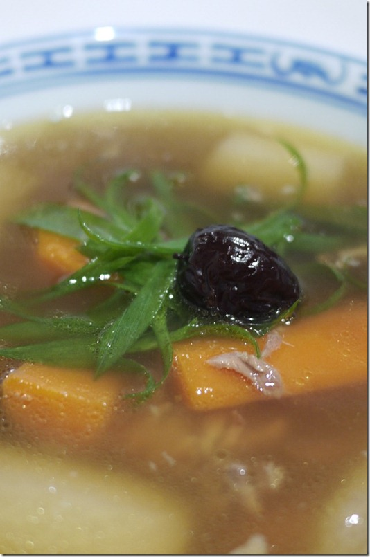 Pork ribs soup with carrots and red plums