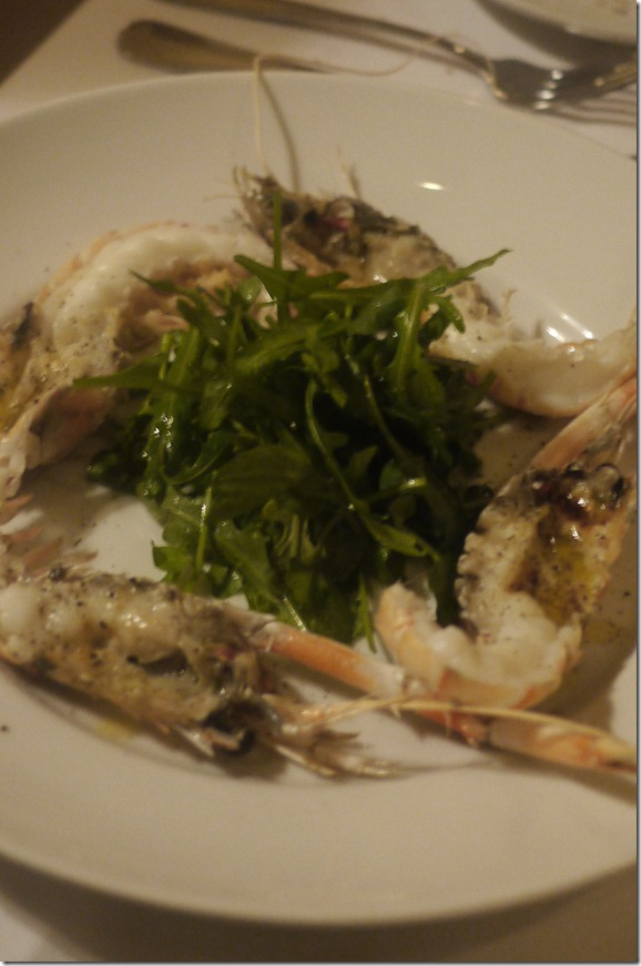 Butter grilled scampi with rocket salad