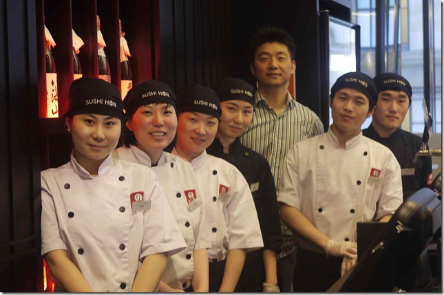 Mr BK Baek (stripe shirt) and his team at Sushi Hon