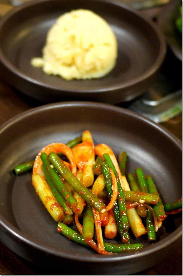 Complimentary banchan - vegetable kimchi