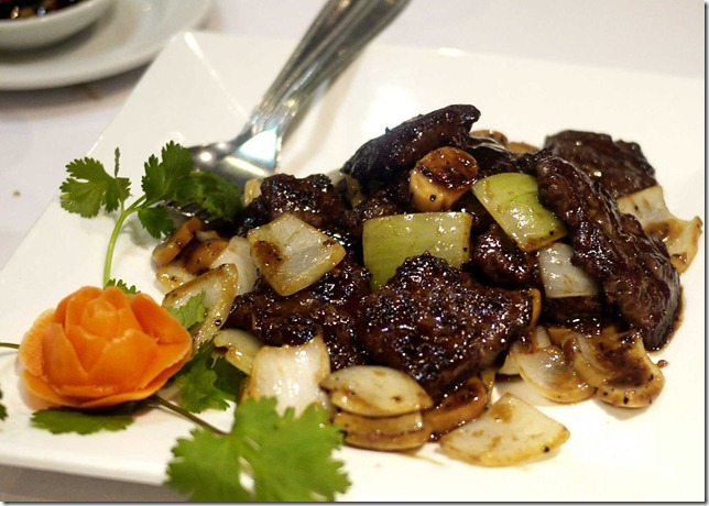 Stir-fried black pepper beef with green onions and button mushrooms
