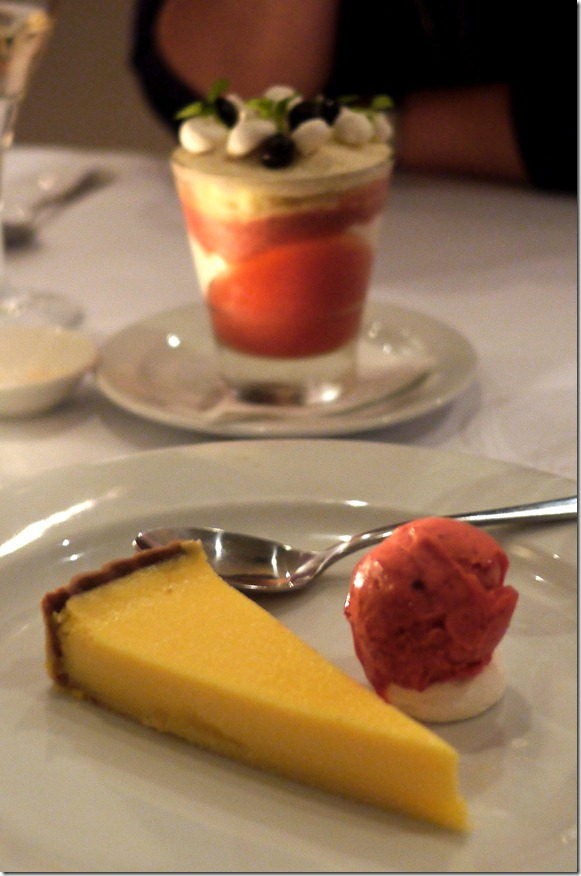 Baked lemon and lime tart with raspberry sorbet and merigue biscuit