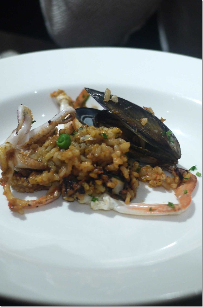 Seafood paella with prawns, black mussels, squid and blue swimmer crab