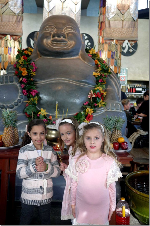 Pretty little maidens with the smiling buddha at Chinta Ria Temple of Love
