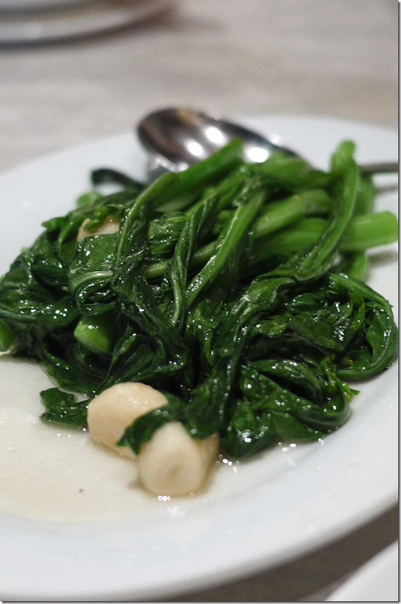 Stir-fry kai lan with garlic