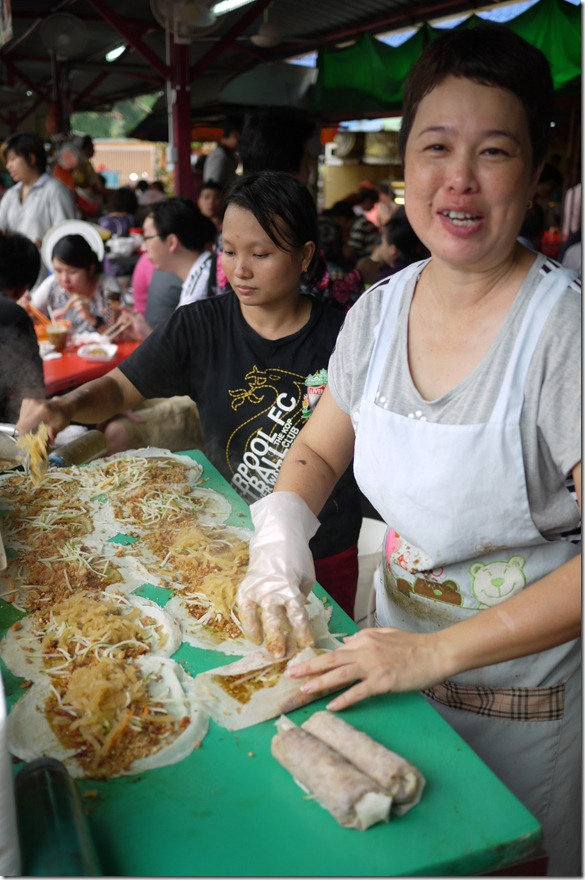 Malaysian popiah being made by the famous Two Sisters at Imbi market