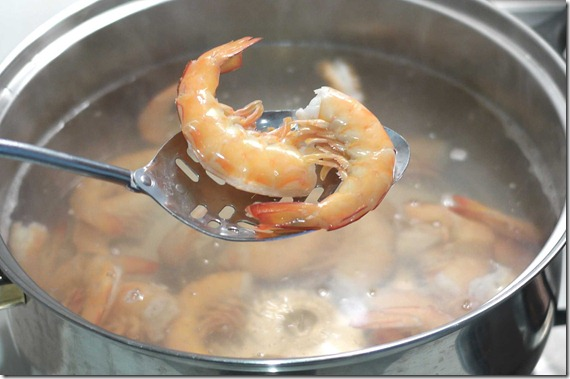 Green prawns cooked in stock pot