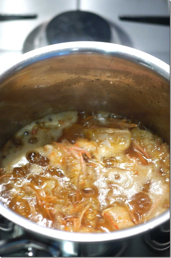 Simmer prawn heads in vegetable oil