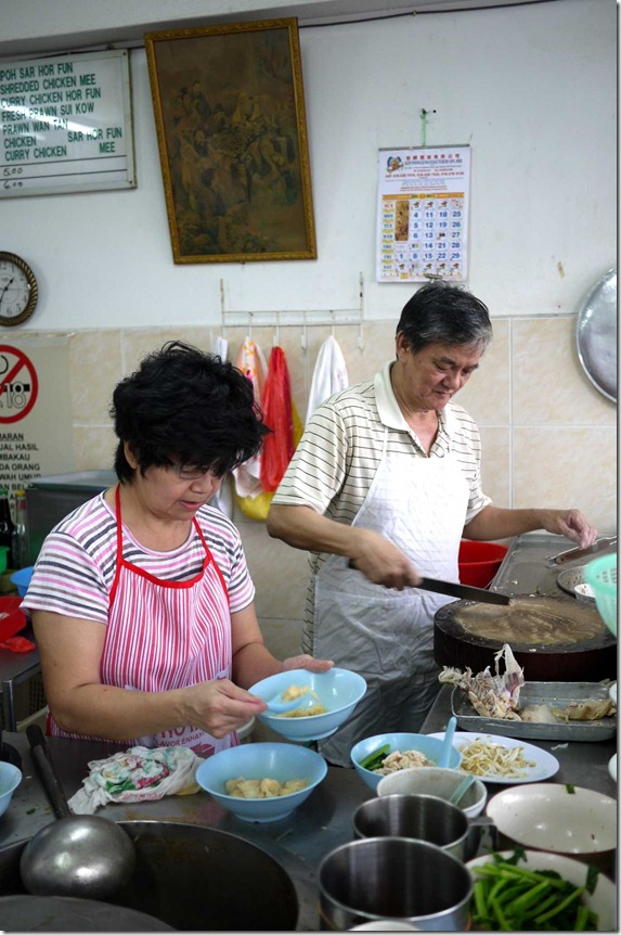 Owners Aunty & Uncle preparing wonton and nooodles