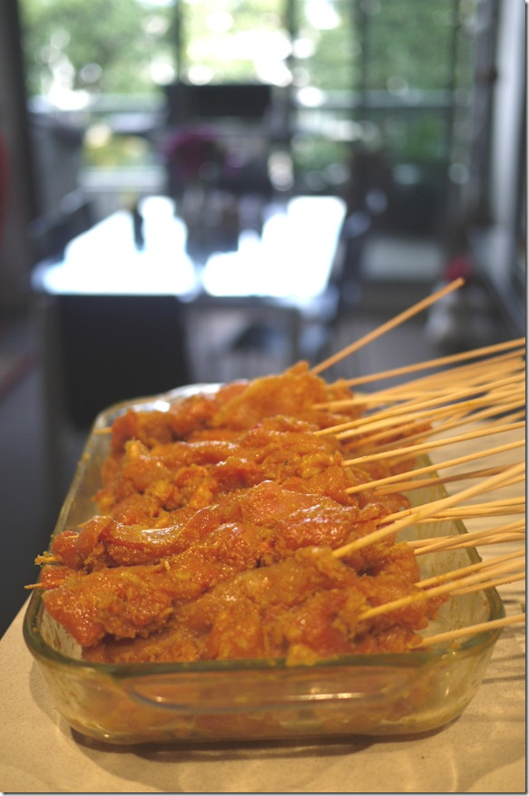 Skewered chicken satays marinating in fragrant paste