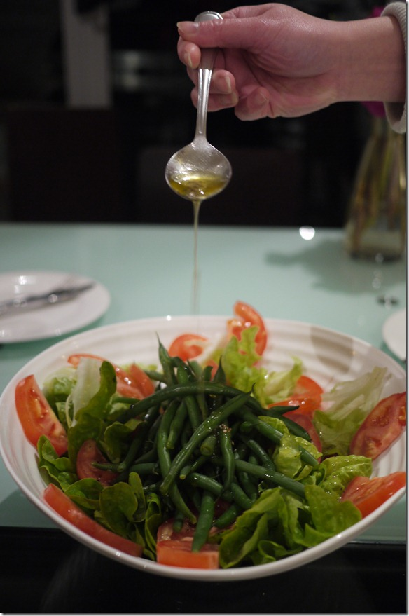 Mysaucepan drizzling dressing onto salad