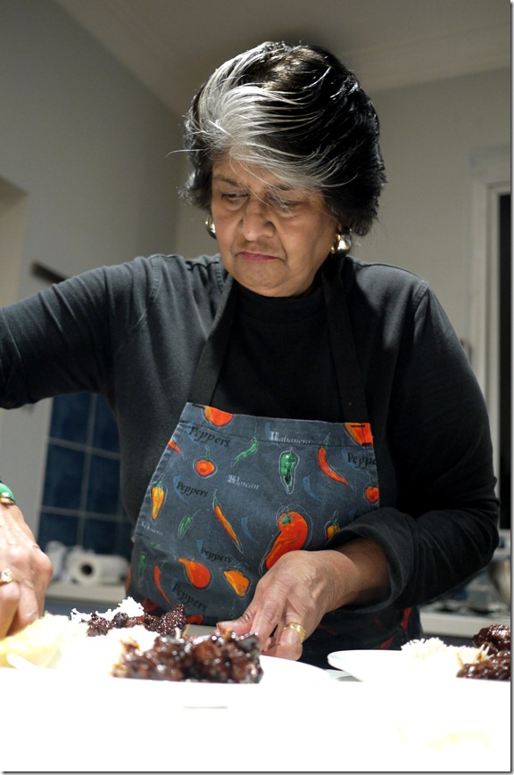 Carol Selva Rajah preparing tau yu bak with basmati rice