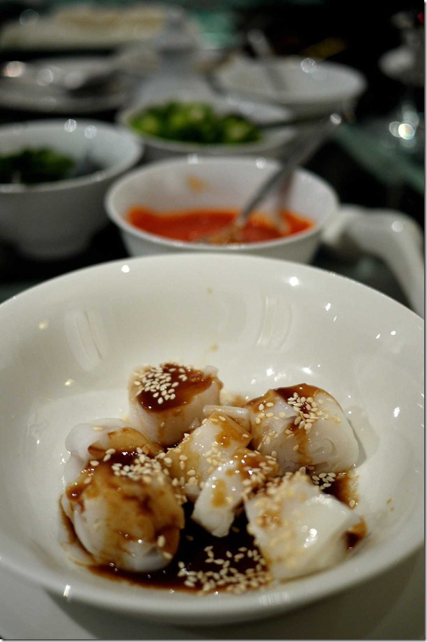 Chee cheong fun or rice noodles with hoisin sauce and roasted sesame seeds