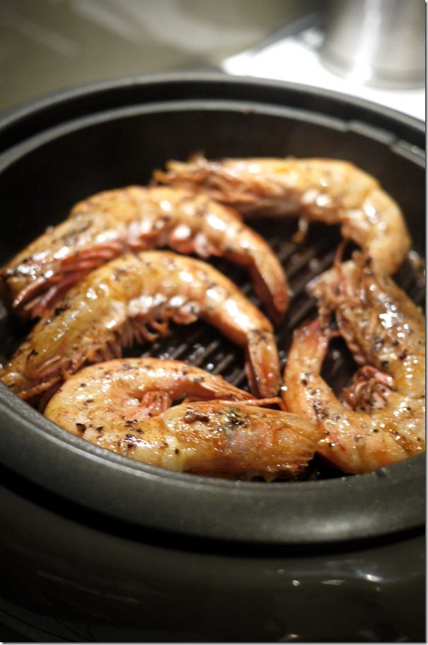 Searing king prawns