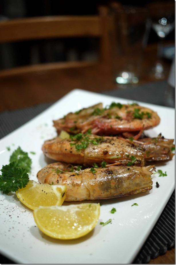 King prawns with herb butter, garlic and continental parsley