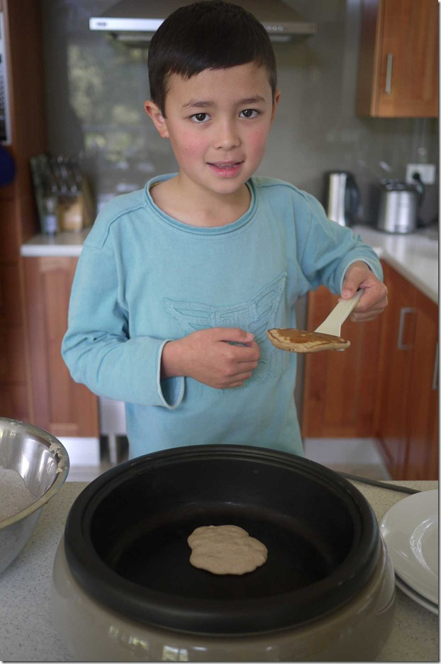Jonah making breakfast pancakes
