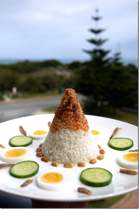 Nasi lemak with sambal, egg, cucumber, peanuts and fried anchovies