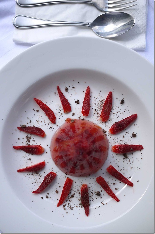 Blood orange jelly with strawberry and chocolate dust