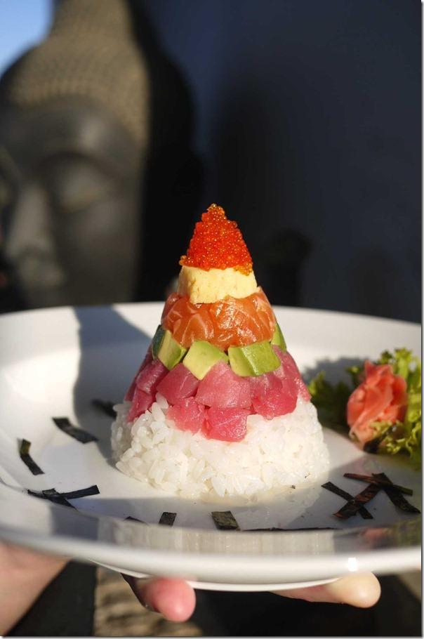 Chirashizushi - tobiko, omelette, salmon, tuna, avocado and sushi rice