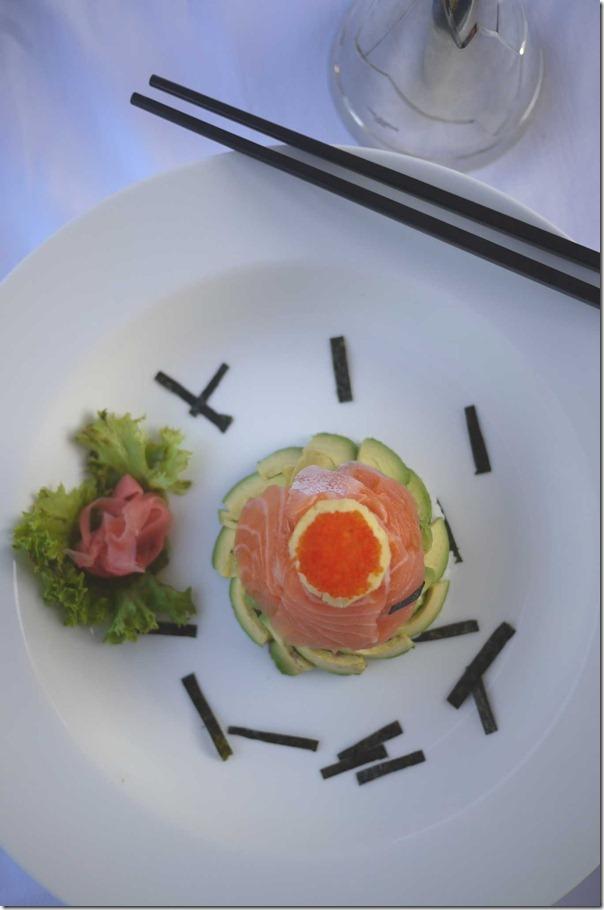 Chirashizushi - tobiko, omelette, salmon, avocado and sushi rice