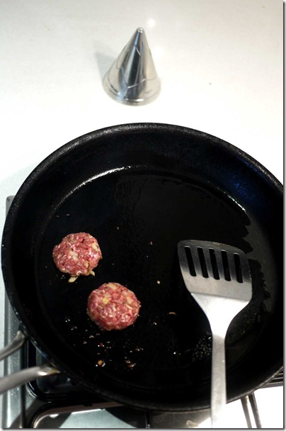 Searing the kangaroo patties
