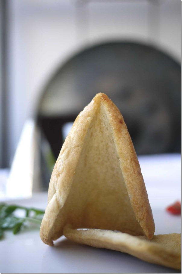 Baked bread in the shape of the Sydney Opera House sail