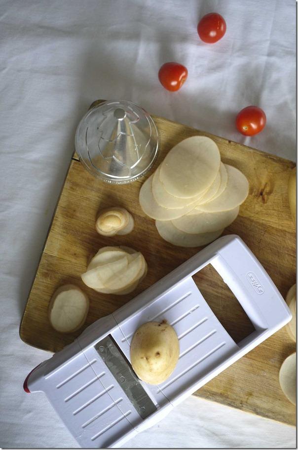 Slicing potatoes with mandolin