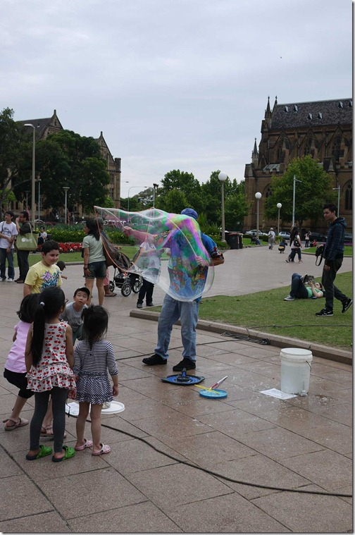 Children enthralled by giant bubble maker