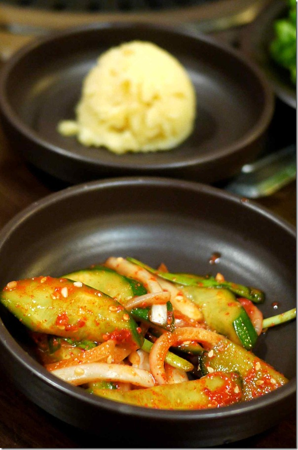 Complimentary banchan - mixed kimchi and potato mash (background)