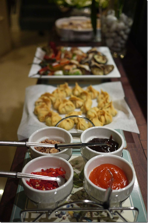 Condiments - clockwise from top left: Deep fried onions, hoi sin sauce, chilli garlic sauce, fresh red chillies