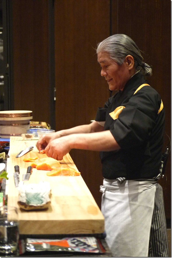 Hideo Dekura, demonstrating the finer points of making sushi