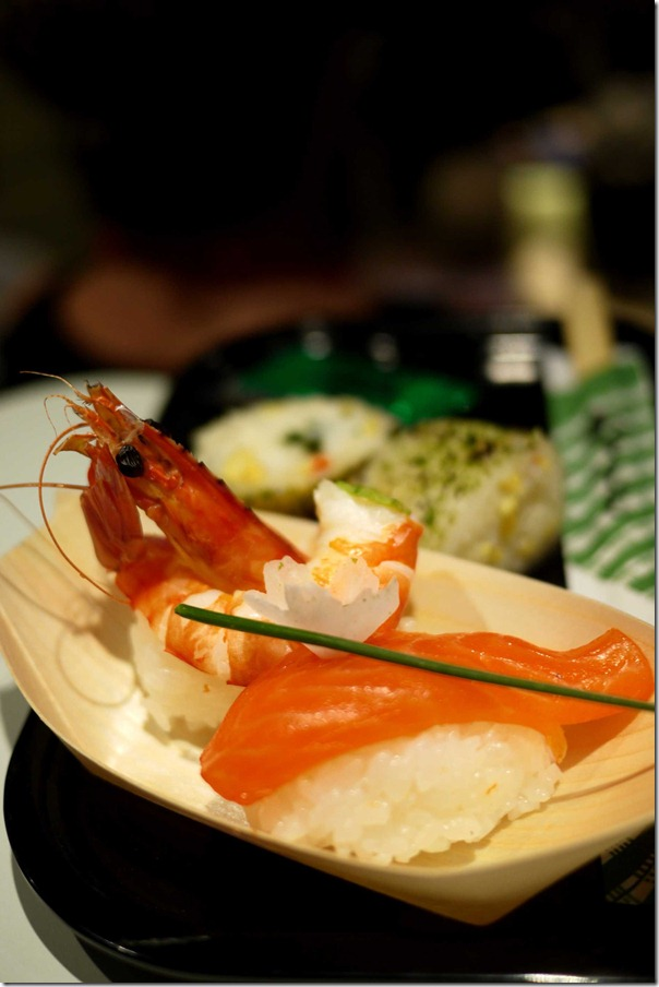 Prawn and salmon sushi with grilled squid