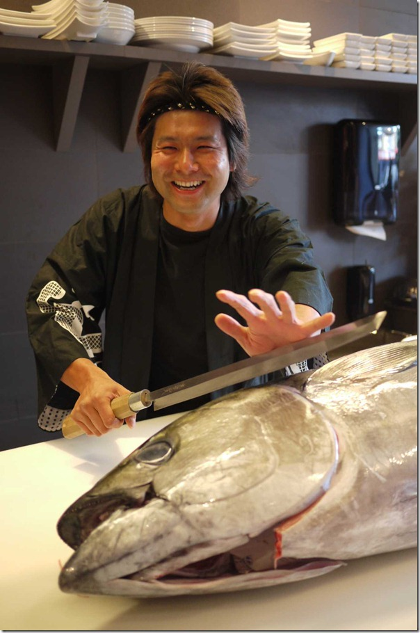 Sushi chef jokingly demonstrates how to prepare sushi