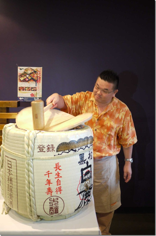 Terry Nishiura christening a sake drum