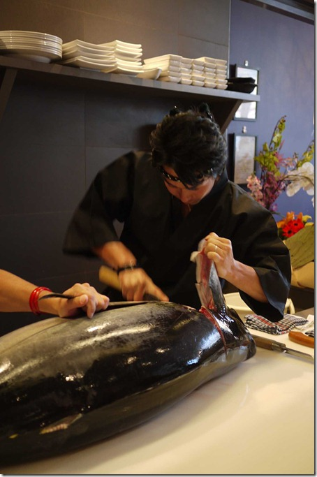 Removing the head is the first step in cutting up the giant tuna