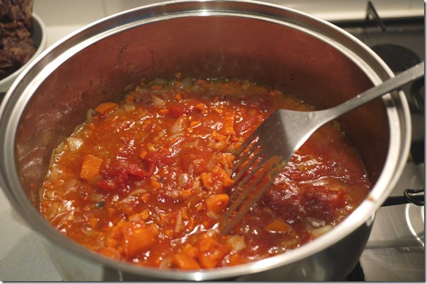 Sautee onions carrots until slightly soft then add canned tomatoes