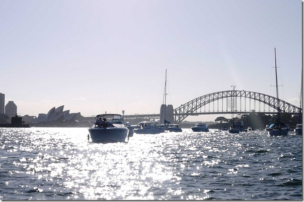 Sydney Opera House and Sydney Harbour Bridge simmering in the water