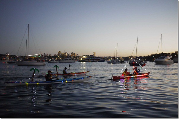 Enthisiastic kayakers doing their rounds in Sydney harbour at dusk