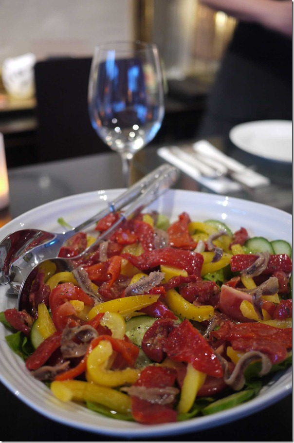 Salad of butter lettuce, sun-dried tomatoes and roasted capsicum