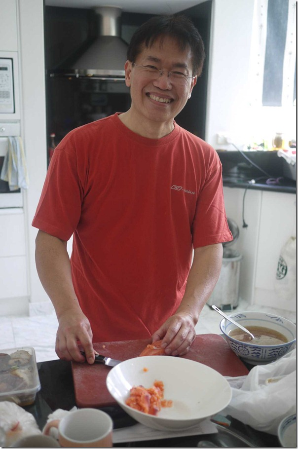 Steven preparing yee sang at home