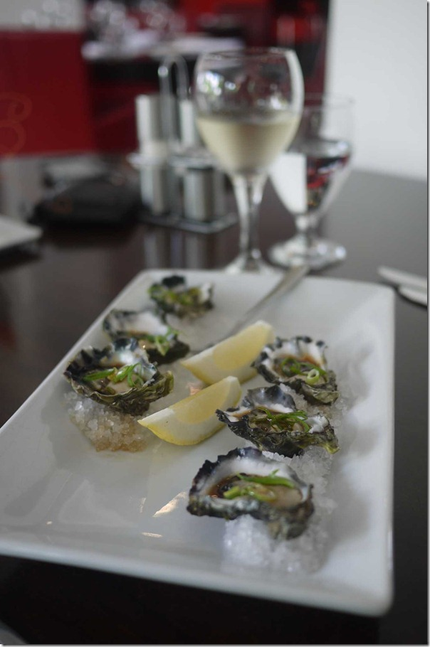 Freshly shucked oysters with seaweed and soy dressing