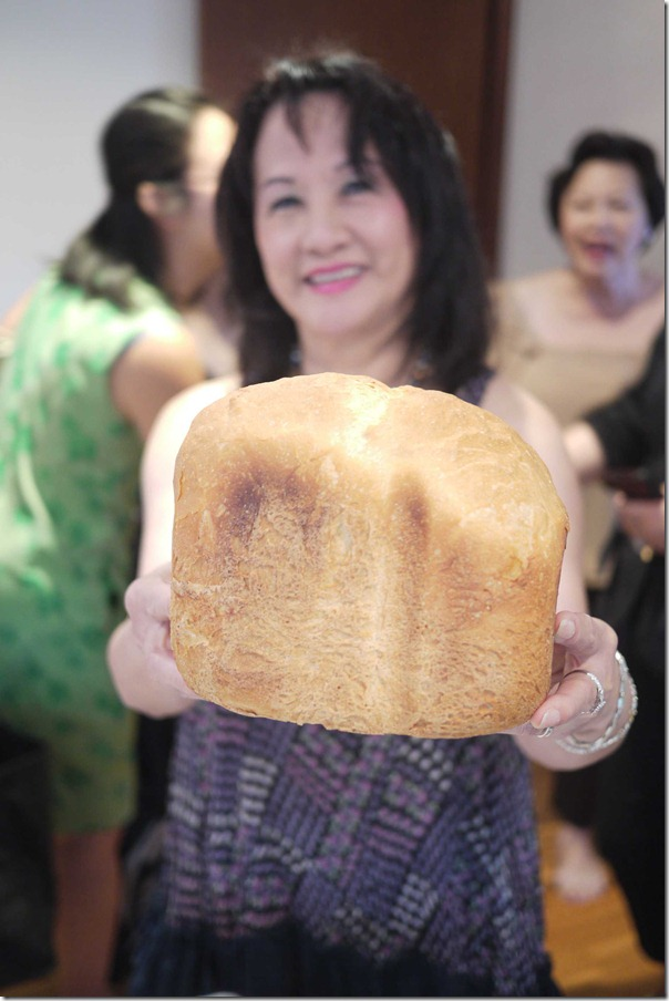 Lena with a loaf of freshly baked bread