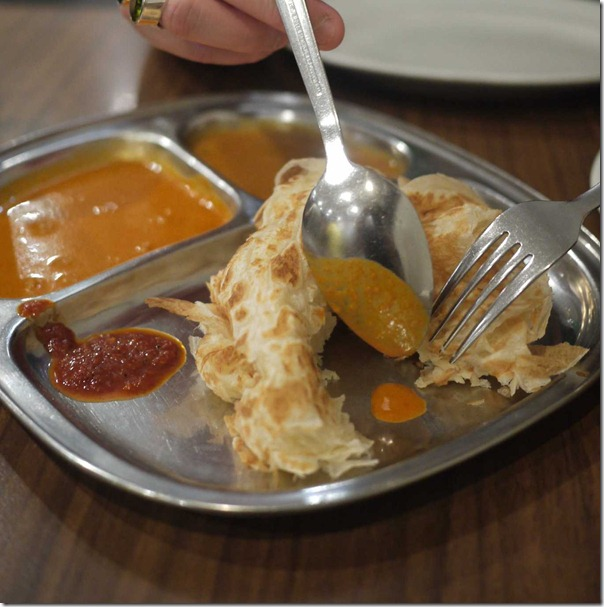 Flaky and crisp: Roti canai with curry sauce, dahl and dallop of sambal