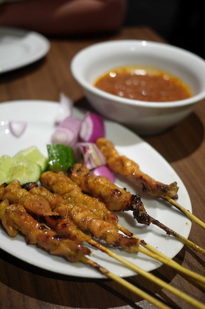 Chicken satays from a charcoal grill