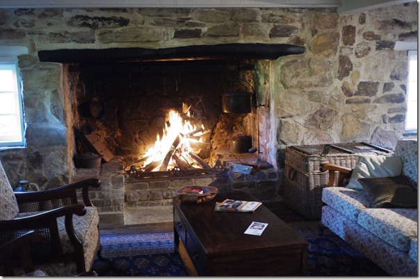 Fireplace and living room at Hatch cottage